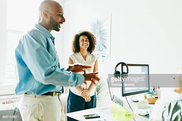 businesswoman laughing during meeting in office - doing a favor stock pictures, royalty-free photos & images