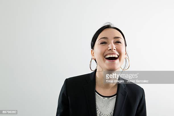 a businesswoman laughing, portrait - hoop earring stock pictures, royalty-free photos & images