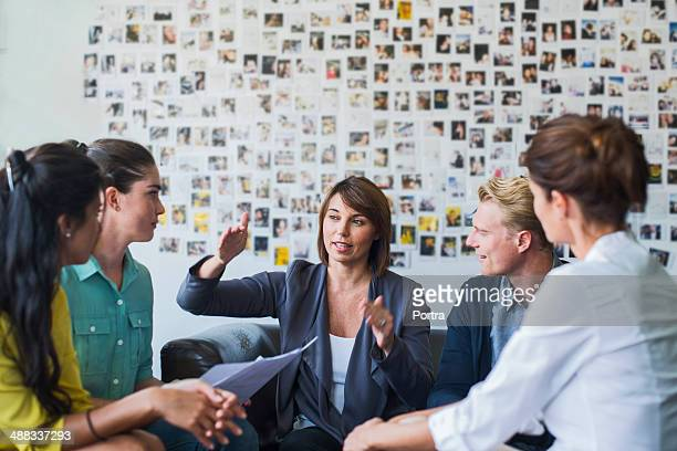 Businesswoman leading a casual meeting