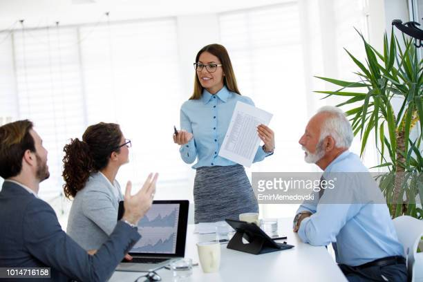 Businesswoman leading business presentation