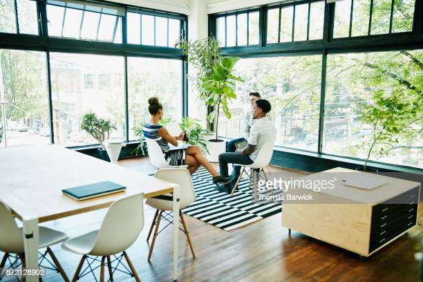 Businesswoman leading client meeting in start up office