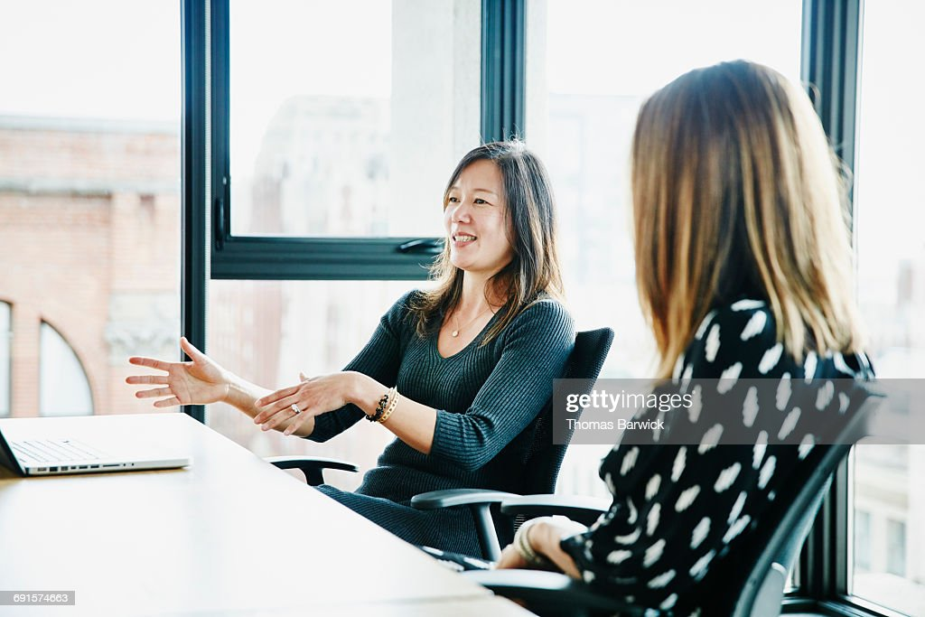 Businesswoman leading discussion during meeting : Stock Photo