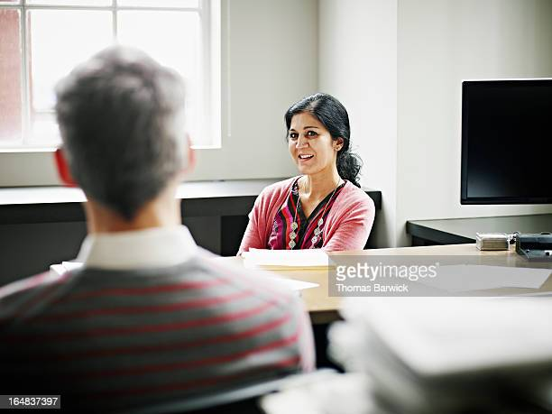 Businesswoman leading discussion with coworker