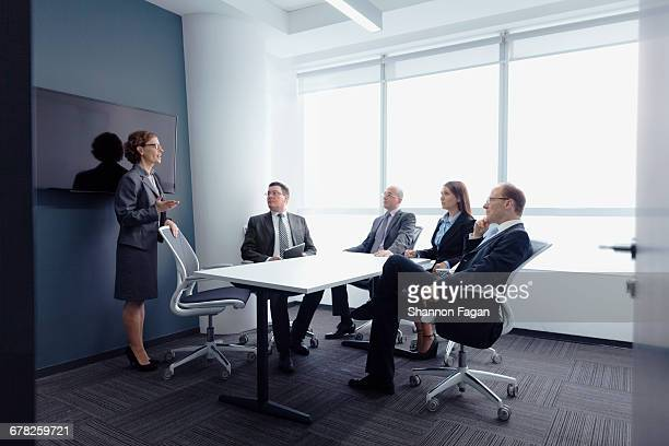 businesswoman leading group meeting in office - leanintogether stock pictures, royalty-free photos & images