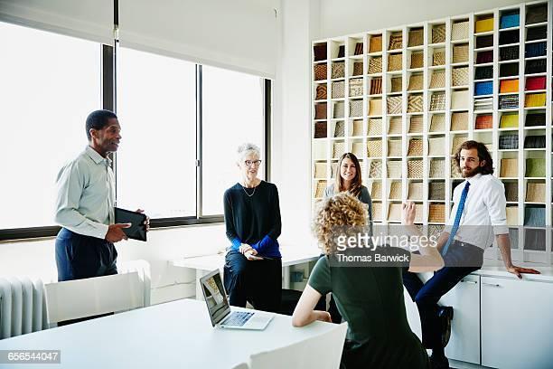 Businesswoman leading informal meeting