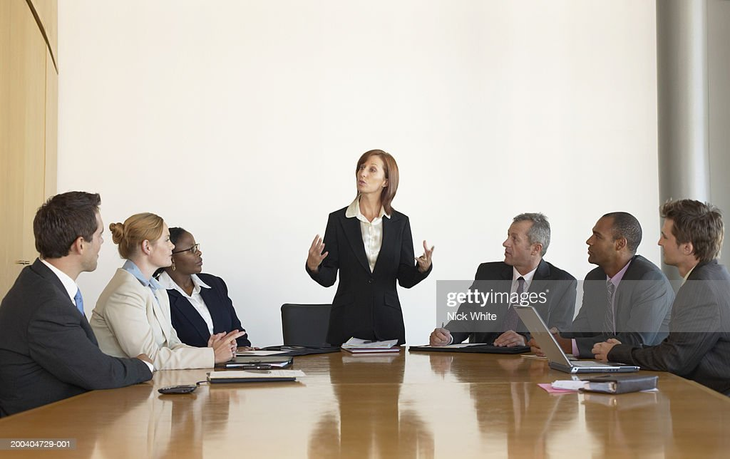 Businesswoman leading meeting in conference room : Stock Photo
