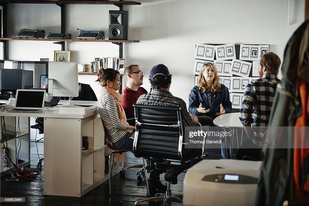 Businesswoman leading meeting in startup office : Stock Photo