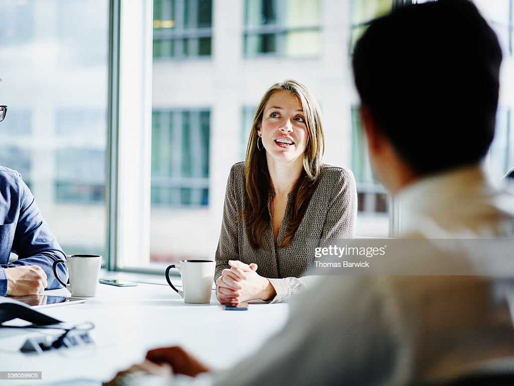Businesswoman leading project discussion in office : Stock Photo