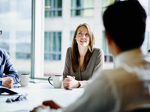 Businesswoman leading project discussion in office - gettyimageskorea