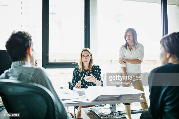 Businesswoman leading project meeting in office