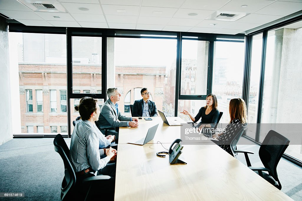 Businesswoman leading project meeting in office : Stock-Foto