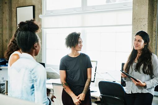 Businesswoman leading team meeting with coworkers in design studio - gettyimageskorea