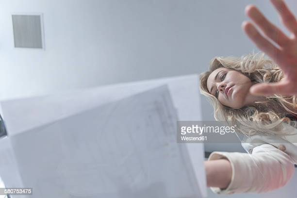 businesswoman leaning on glass table looking at documents - directly below stock pictures, royalty-free photos & images