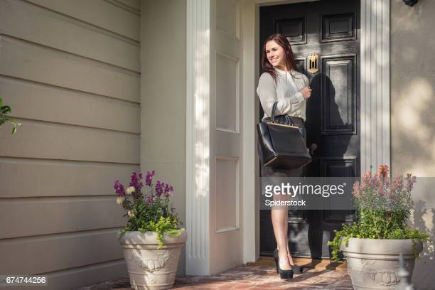 businesswoman leaving for work - leaving stock pictures, royalty-free photos & images
