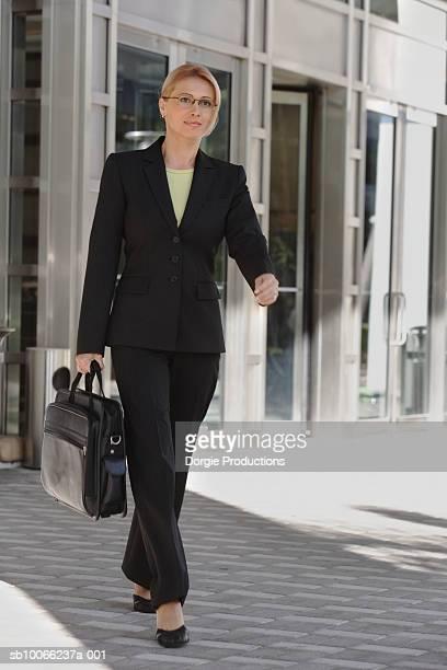 Businesswoman leaving office premises