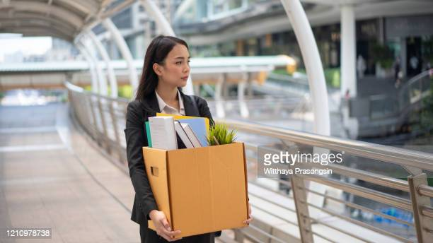 businesswoman leaving office with box of personal items - being fired photos stock pictures, royalty-free photos & images