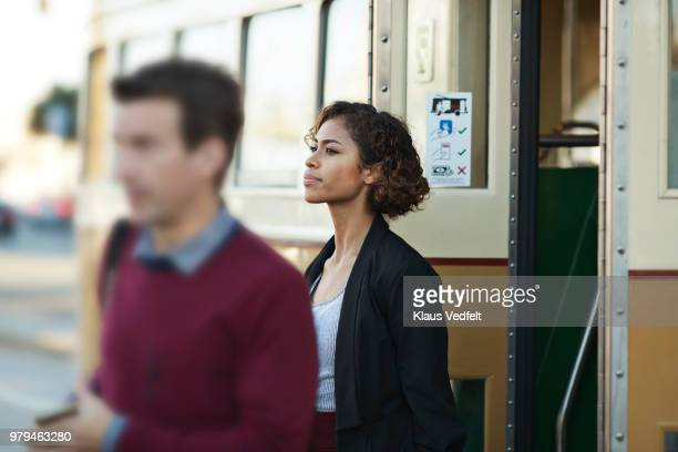 Businesswoman leaving tram in San Francisco