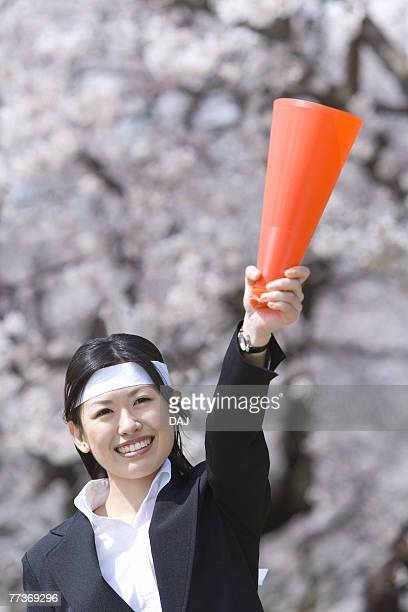 Businesswoman Lifting A Megaphone, Front View, Head and Shoulder, Differential Focus
