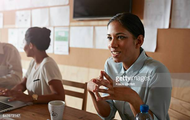 Businesswoman listening, at meeting