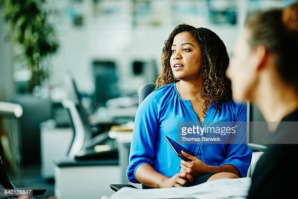 Businesswoman listening during meeting