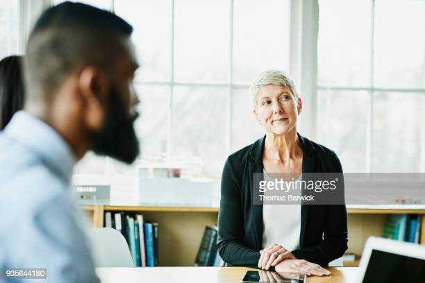 Businesswoman listening during project meeting in office conference room