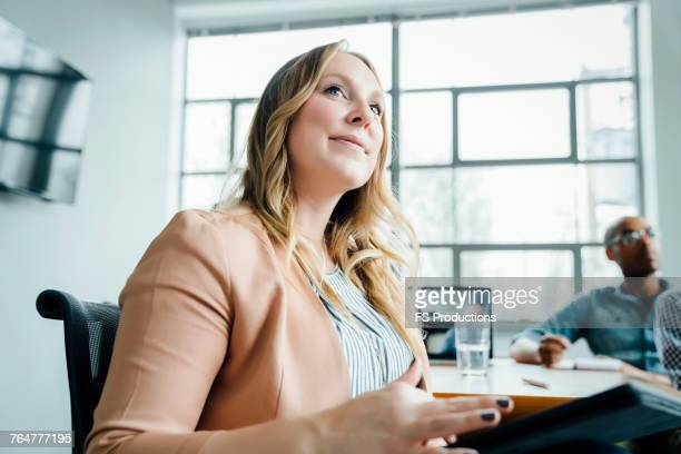 businesswoman listening in meeting - low angle view stock pictures, royalty-free photos & images