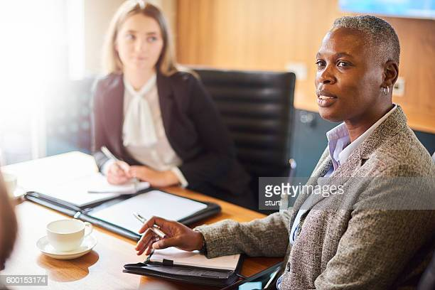 businesswoman listening to colleagues