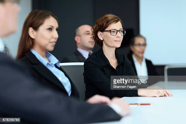 Businesswoman listening to presentation in meeting