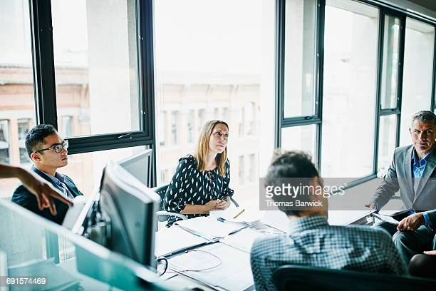 Businesswoman listening to project ideas