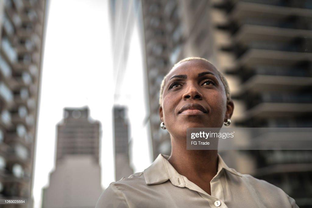 Businesswoman loking away outdoors : Stock Photo