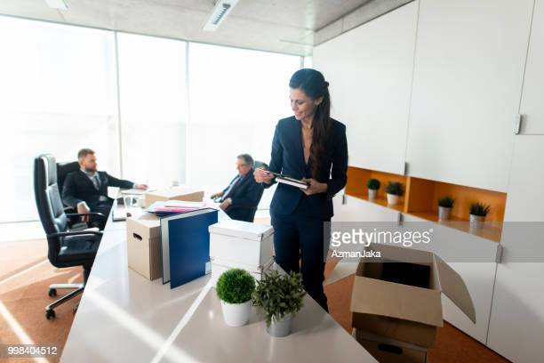 businesswoman looking at a file in the office - arranging stock pictures, royalty-free photos & images