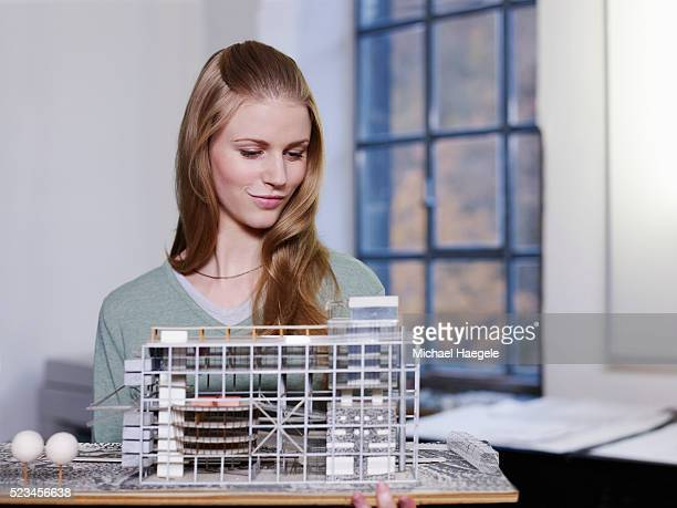 businesswoman looking at architecture model - architectural model stock pictures, royalty-free photos & images