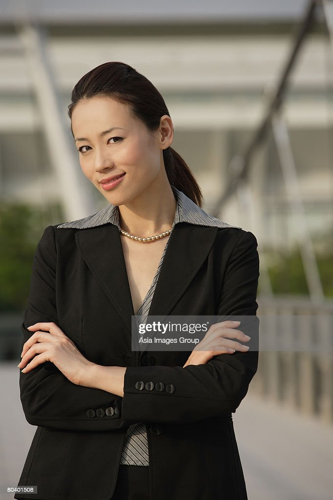 Businesswoman looking at camera : Stock Photo