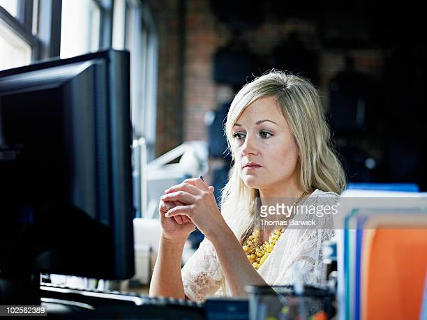 Businesswoman looking at computer monitor