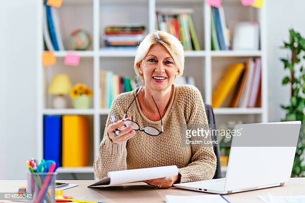 Businesswoman looking at market analysis
