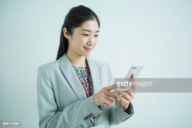 Businesswoman looking at smart phone