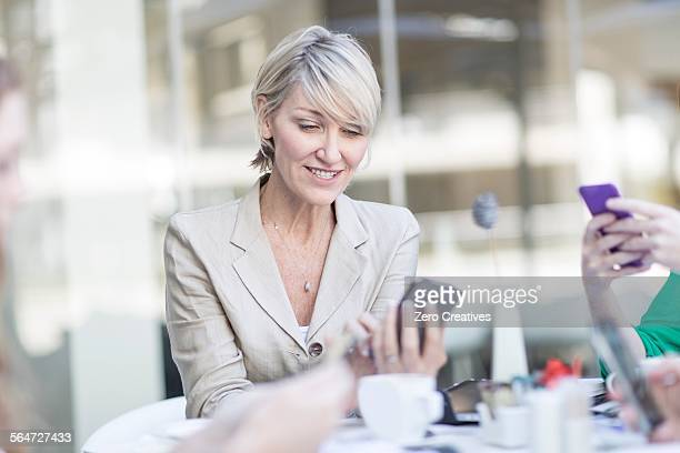 Businesswoman looking at smartphone on hotel terrace