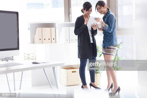 Businesswoman looking at the image of the tablet