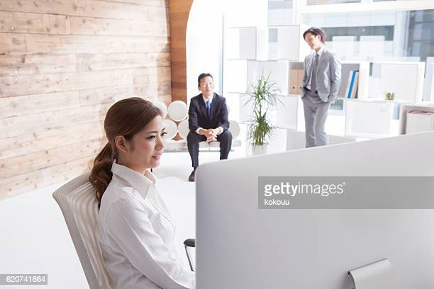 Businesswoman looking at the personal computer in the stylish office