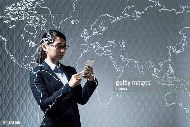 Businesswoman looking at the smartphone