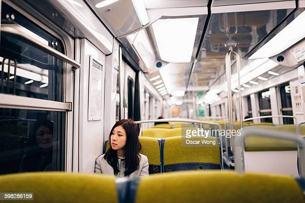 Businesswoman looking away in train