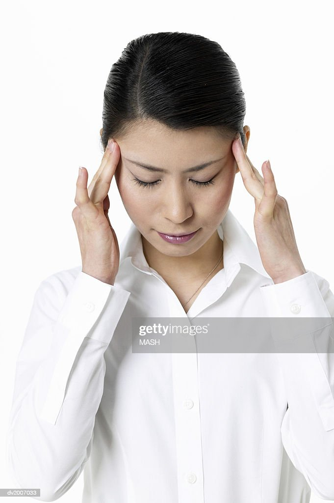 Businesswoman Looking Down With Her Hands on Her Head : Stock Photo