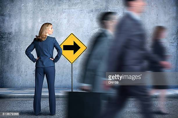Businesswoman Looking In The Direction Everyone Is Walking