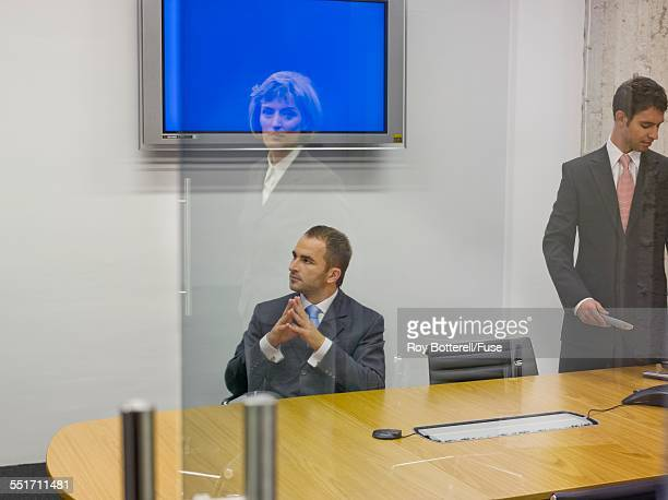 Businesswoman Looking into Conference Room
