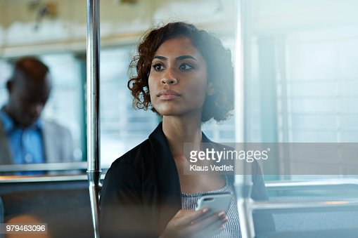 Businesswoman looking out of the window of tram in San Francisco