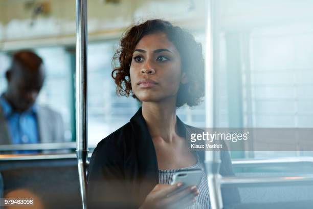 businesswoman looking out of the window of tram in san francisco - rush hour stock pictures, royalty-free photos & images