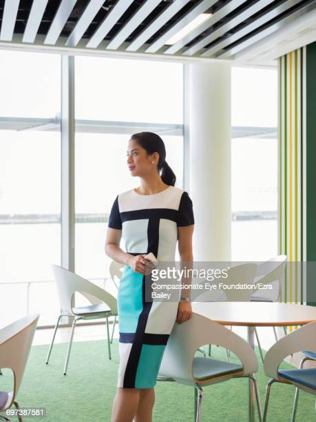 Businesswoman looking out of window in cafe
