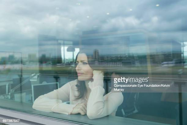 Businesswoman looking out of window in office