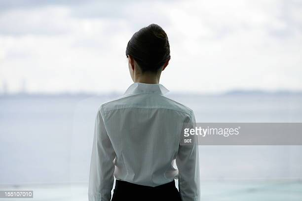 Businesswoman looking out window,rear view