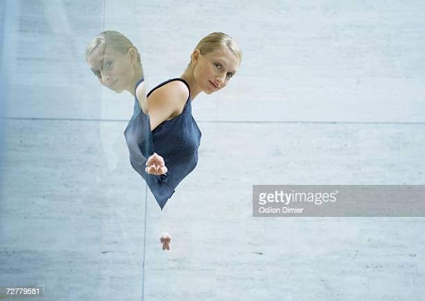 Businesswoman looking over edge of balcony